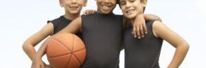 Three Kids Holding a Basketball