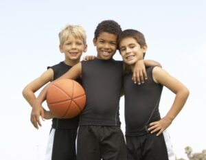 Three Kids Holding a Basketball